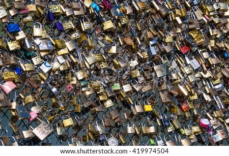 PARIS, FRANCE  21 SEPTEMBER 2012: Locks on the fence of the bridge of lovers in Paris. 21 September, 2012. Paris, France.