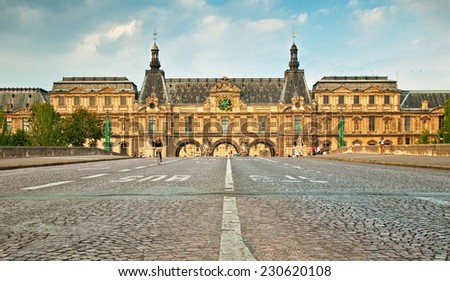 PARIS, FRANCE - 8 SEPTEMBER, 2014: Louvre Museum in Paris, France on 8 September 2014. Louvre Museum is one of the world's largest museums and a historic monument - stock photo
