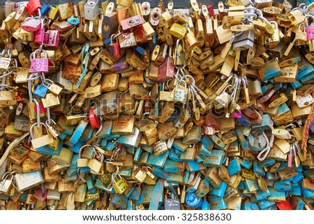PARIS, FRANCE - SEPTEMBER 4: Many love locks on the bridge in Paris on September 4, 2015