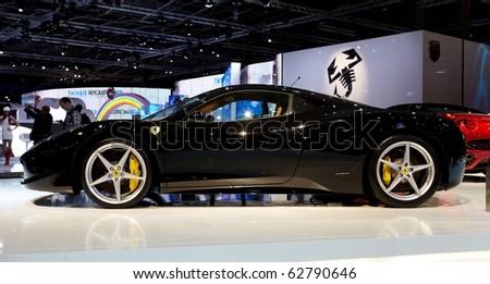 PARIS, FRANCE - SEPTEMBER 30: Paris Motor Show on September 30, 2010 in Paris, showing Ferrari 458 Italia, side view - stock photo