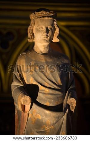 Paris, France - September 8, 2014: Paris - Sainte Chapelle. Statue of Louis IX  King of France   - stock photo