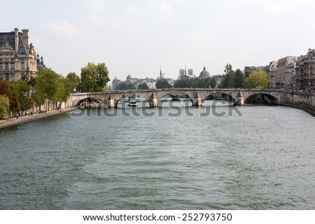 PARIS, FRANCE - SEPTEMBER 7, 2014: Paris -  Seine between Louvre and the Museum D'Orsay