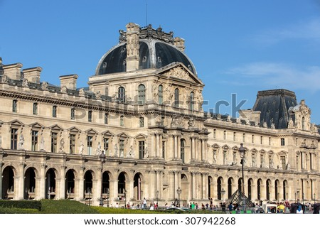 PARIS, FRANCE - SEPTEMBER 9, 2014: Paris - The Louvre Museum. Louvre is one of the biggest Museum in the world, receiving more than 8 million visitors each year.