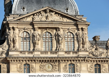 PARIS, FRANCE - SEPTEMBER 9, 2014: Paris - The Louvre Museum. Louvre is one of the biggest Museum in the world, receiving more than 8 million visitors each year.  - stock photo