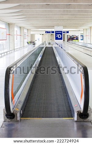 Paris, France, September 28, 2014 - Passenger's escalator in airport terminal - stock photo