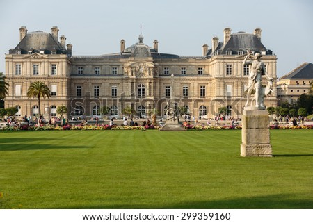 PARIS, FRANCE - SEPTEMBER 8, 2014: People enjoy sunny day in the Luxembourg Garden in Paris. Luxembourg Palace is the official residence of  the French Senate.  - stock photo
