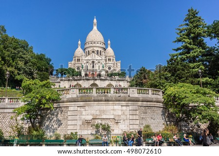 PARIS, FRANCE - SEPTEMBER 06, 2016: People relax near Basilica of the Sacred Heart of Paris on Montmartre hill.