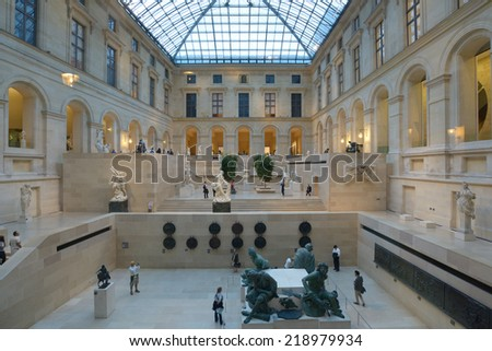 PARIS, FRANCE - SEPTEMBER 11, 2013: People visiting the Louvre museum. The Louvre is the world's most visited museum, and received more than 9.7 million visitors in 2012