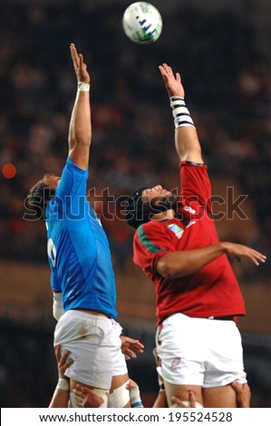 PARIS, FRANCE-SEPTEMBER 20, 2007: portuguese and italian players try to catch the ball in touche, during the match Portugal vs Italy at the Rugby World Cup, France 2007, in Paris. - stock photo