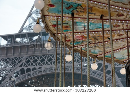 PARIS, FRANCE - SEPTEMBER 9, 2014: The Eiffel Tower seen from  carousel, Paris, France  - stock photo