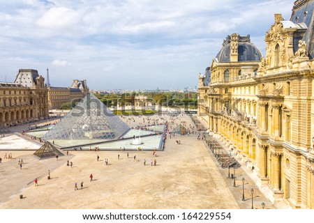 PARIS, FRANCE - SEPTEMBER 20: The Louvre Museum facade on September 20, 2012 in Paris. Louvre is one of the biggest Museum in the world, receiving more than 8 million visitors each year. - stock photo