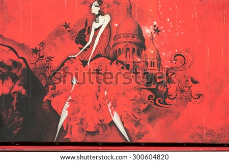 PARIS, FRANCE - SEPTEMBER 10, 2014: The Moulin Rouge in Paris, France. Moulin Rouge is the most famous Parisian cabaret and it created the modern can-can dance. - stock photo