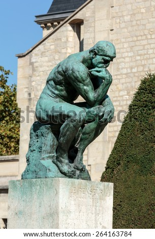PARIS, FRANCE - SEPTEMBER 12, 2014:The Thinker, a famous statue by Auguste Rodin in Rodin Museum in Paris - stock photo