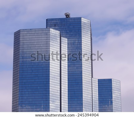 PARIS, FRANCE - SEPTEMBER 21, 2011: Tour Total is an office skyscraper located in La Defense district, the modern side of Paris city, capital of France. Photo taken on September 21, 2011 in Paris. - stock photo