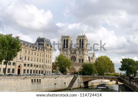PARIS, FRANCE - SEPTEMBER, 26: Tourists visits Notre Dame cathedral on September 26, 2012 in Paris. Notre Dame de Paris receives about 12 million visitors annually. - stock photo