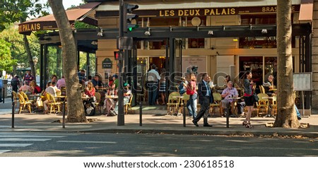 PARIS, FRANCE - 07 SEPTEMBER, 2014: Typical bar in the old town of Paris, France on 7 September 2014. . Paris is one of the most populated metropolitan areas in Europe full of bars and cafes. - stock photo