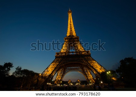 PARIS, FRANCE- SEPTEMBER 21, 2016: view of Eiffel Tower with light performance show. Eiffel Tower is the famous landmark of Paris.