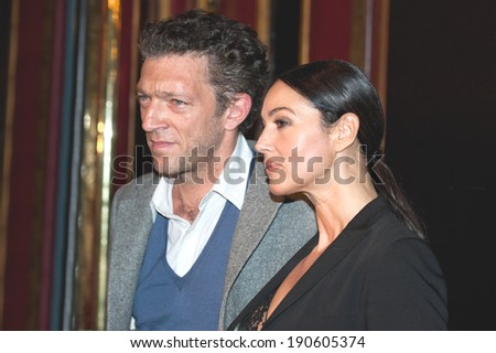 PARIS, FRANCE - SEPTEMBER 28, 2011 : Vincent cassel and Monica Bellucci at the french premiere of The artist in Paris at le Grand Rex theater - stock photo