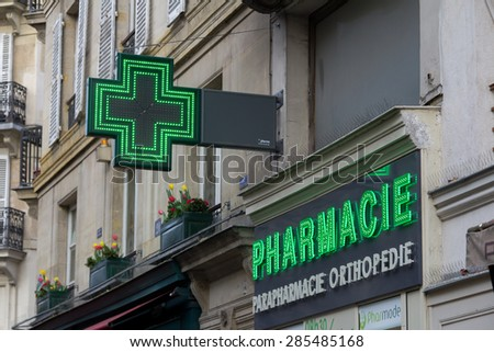 PARIS, FRANCE - 19TH MARCH 2014: A closeup to a sign outside a pharmacy in Paris - stock photo