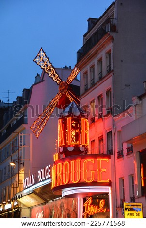 PARIS FRANCE  19, 2014: The Moulin Rouge night lights in Paris, France. Moulin Rouge is a famous cabaret built in 1889, locating in the Paris red-light district of Pigalle. - stock photo