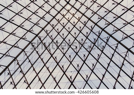 PARIS, FRANCE - 08.16.2004. - The Pyramid abstract metal and glass view inside the Louvre museum - stock photo