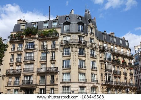 Paris, France - typical old apartment building. Windows and balconies. - stock photo