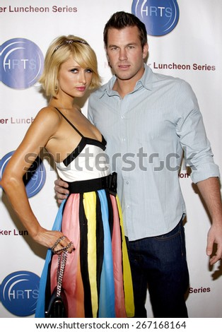 """Paris Hilton and Doug Reinhardt at the HRTS' """"Broadcasting Reality: Show Me the Money!"""" Newsmaker Luncheon held at the Beverly Hilton Hotel in Los Angeles, United States, 220409.  - stock photo"""