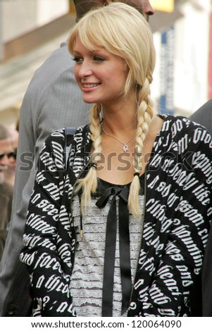 Paris Hilton at the Ceremony Honoring Los Angeles Lakers Owner Jerry Buss with the 2,323rd star on the Hollywood Walk of Fame. Hollywood Boulevard, Hollywood, CA. 10-30-06 - stock photo