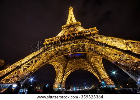 PARIS - January 2 : Details of the illuminated Eiffel Tower by night. The most recognizable landmark of the world. January 2, 2016 in Paris, France - stock photo