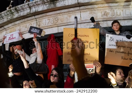 PARIS - JANUARY 8: Peaceful protest in Place de la Republique against the terrorist attack on Charlie Hebdo journal, promoting freedom of speech in Paris, France on 08 January 2015  - stock photo