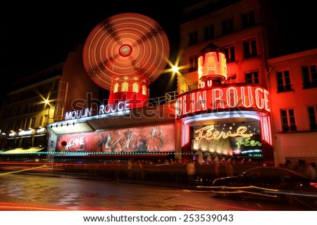 PARIS - JANUARY 31, 2015: The Moulin Rouge by night, on January 31, 2015 in Paris, France. Moulin Rouge is best known as the spiritual birthplace of the modern form of the can-can dance.