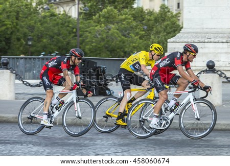 PARIS-JUL 24: Chriss Froome wearing the Yellow Jersey, Greg Van Avermaet and Damiano Caruso passing by the Arch de Triomphe on Champs Elysees in Paris during the latest stage of Tour de France 2016.