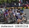 PARIS, JUL 22:The peloton riding during the final stage of Le Tour de France 2012 on Avenue des Champs Elysees on 22 July 2012 in Paris,France. - stock photo
