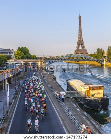 PARIS,JUL 21:The peloton riding on the Seine riverside near the Eiffel Tower during the last stage of the 100th edition of Le Tour de France on July 21, 2013 in Paris - stock photo
