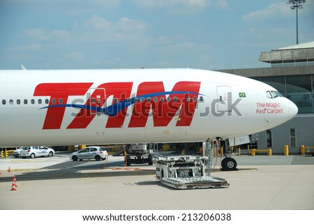 PARIS - JULY 16, 2014: A Boeing 777 from TAM Airlines at Roissy airport, near Paris. TAM is the Brazilian brand of Latam Airlines and the largest Brazilian airline by market share and fleet size. - stock photo