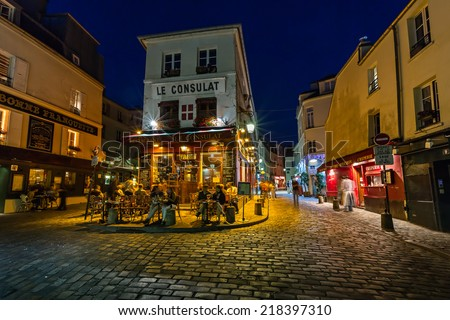 PARIS - JULY 2: Cafe Le Consulat on Montmartre on July 1, 2013 in Paris. Montmartre area is among most popular destinations in Paris, Le Consulat is a typical Paris cafe. - stock photo