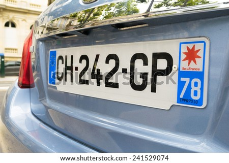 PARIS - JULY 20, 2014: Car plate. The new format was adopted in France on 14 April 2009, and is similar to the one successfully introduced in Italy. - stock photo