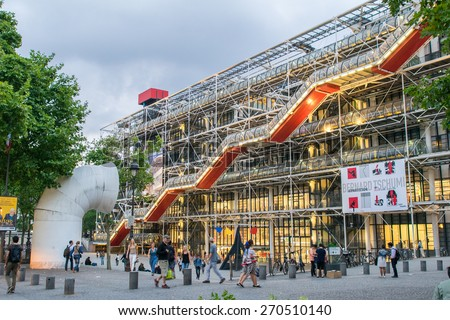 PARIS - JULY 21, 2014: Facade of the Centre of Georges Pompidou in Paris, France. The Centre of Georges Pompidou is one of the most famous museums of the modern art in the world. - stock photo