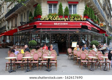 PARIS - JULY 21: Le Champ de Mars cafe on July 21, 2011 in Paris, France. Le Champ de Mars cafe is a typical establishment for Paris, one of largest metropolitan areas in Europe. - stock photo