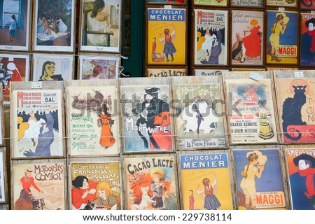 PARIS - JULY 9: Old art prints for sale in Montmartre, Paris. Montmartre is a 130 metros high hill known for its night clubs and artists studios on July 9th, 2014 in Paris, France.