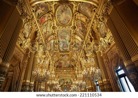PARIS - JULY 6: Opera Garnier is the most famous Opera house in the world, known for the baroque opulence of the interiors, on July 6, 2014 in Paris. - stock photo