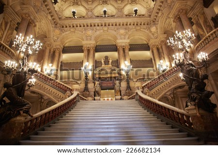 PARIS - JULY 6: Opera Garnier stairway, interior. Is the most famous Opera house in the world, known for the baroque opulence of the interiors, on July 6, 2014 in Paris. - stock photo