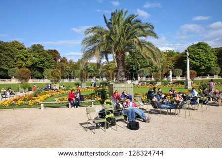 PARIS - JULY 23: People rest in Luxembourg Gardens on July 23, 2011 in Paris, France. Paris is the most visited city in the world with 15.6 million international arrivals in 2011. - stock photo