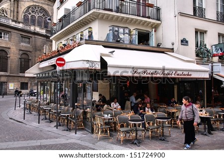 PARIS - JULY 20: People visit Cafe La Pointe Saint Eustache on July 20, 2011 in Paris, France. The cafe is a typical establishment for Paris, one of largest metropolitan areas in Europe. - stock photo