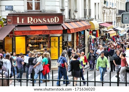 PARIS - JULY 22: People visit Le Ronsard cafe on July 22, 2011 in Paris, France. Paris is the most visited city in the world with 15.6 million international arrivals in 2011. - stock photo