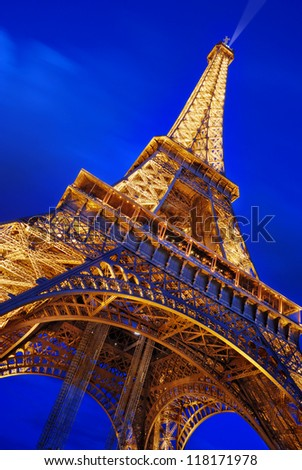 PARIS - JULY 20: The Eiffel Tower from below upwards in the evening on July 20, 2012 in Paris, France. The tower is the tallest structure in Paris and the most-visited monument in the world. - stock photo
