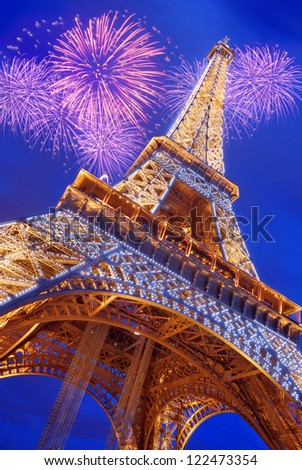 PARIS - JULY 14: The Eiffel Tower from below upwards in the evening on July 14, 2012 in Paris, France. The Eiffel Tower is most famous sights of Paris. - stock photo