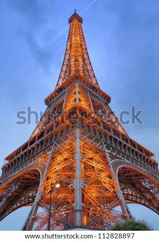 PARIS - JULY 30: The Eiffel Tower from below upwards on July 30, 2012 in Paris, France. Eiffel Tower is lit by more than 350 lamps mounted within the structure of the tower itself.
