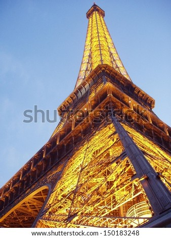 PARIS- July 14: The Eiffel Tower is illuminated in preparation of Bastille Day celebrations on July 14, 2006 in Paris, France.