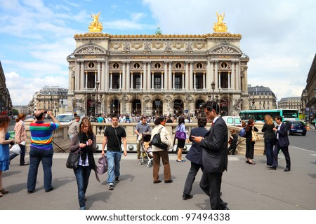 PARIS - JULY 22: Tourists visit Opera Garnier on July 22, 2011 in Paris, France. Opera Garnier is a popular landmark among tourists in Paris, the most visited city worldwide. - stock photo